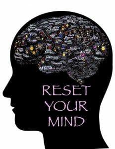 Illustration des Kopfes, Umriss des Gehirns und die Inschrift: reset your mind